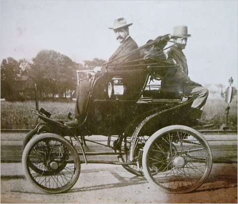 Inventor Riker in his electric car (photo courtesy of wheels.blogs.nytimes.com)