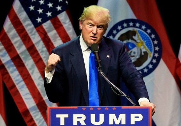 Republican presidential candidate Donald Trump describes how he was ready to punch a person who rushed the stage during an election rally earlier in the day, as he speaks to a crowd in Kansas City, Mo., Saturday. CREDIT: AP Photo/Nati Harnik