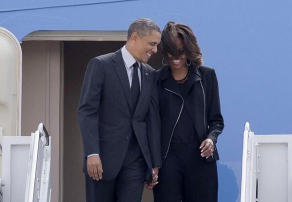 Barack and Michelle, side by side, as a loving couple should be...