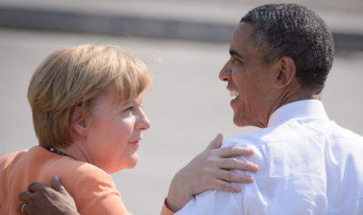 Notice that German Chancellor Angela Merkel doesn't mind President Obama touching her.